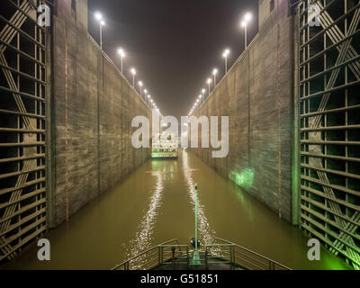 China, Hubei Sheng, river cruise on the Yangtze River, In Three Gorges Dam on the Yangtze River at night - Stock Photo