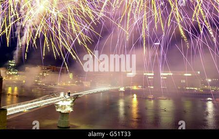 Millennium Bridge fireworks - Stock Photo