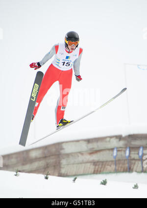 A nordic ski jumper in mid air during the FIS Cup of ski jumping at the Whistler Olympic Park.  Whistler BC, Canada. - Stock Photo
