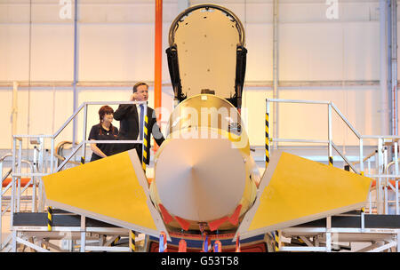 Prime Minister David Cameron views the Eurofighter Typhoon with apprentice Lauren Nuttall (left) during a visit to BAE Systems in Warton, Lancashire.