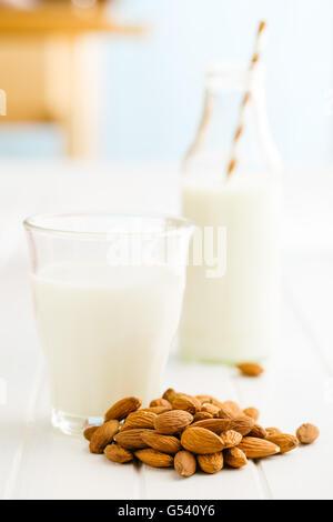 Almond milk and almonds. Tasty milk in glass. - Stock Photo