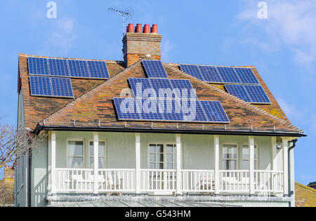 Solar panels on the roof of an old house in the UK. - Stock Photo