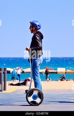 Man with helmet riding Segway near the beach. Barcelona, Catalonia, Spain. - Stock Photo