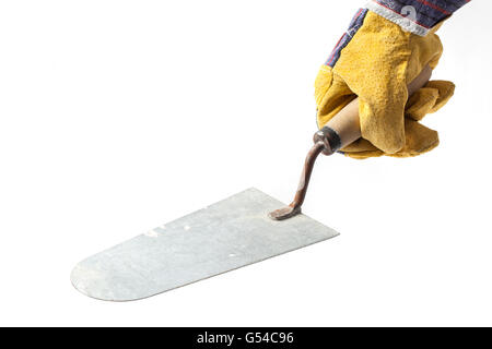 Hand of a worker in protection glove with a trowel on white background. - Stock Photo