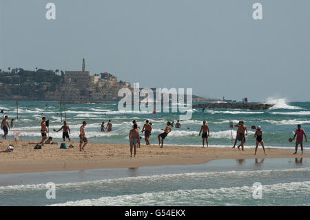Tel Aviv beach with Jaffa in the background. - Stock Photo