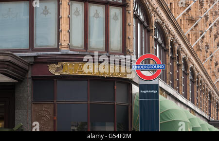 LONDON, ENGLAND - OCTOBER 19, 2015: London underground sign at the famous Harrods store in the Knightsbridge district - Stock Photo