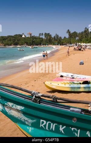 Sri Lanka, Galle Province, Unawatuna, tourists walking on, artificial imported sand beach - Stock Photo