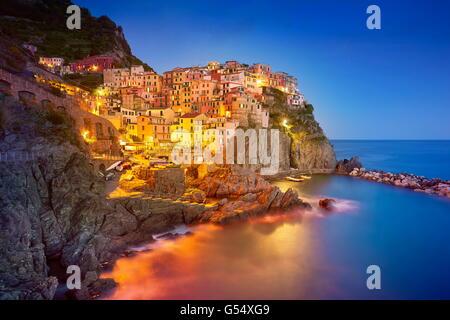 Manarola at evening night, Cinque Terre National Park, Liguria, Italy, UNESCO - Stock Photo