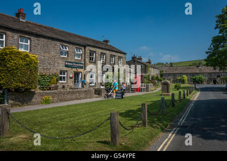 The beautiful Yorkshire road through the countryside village of Burnsall, England, UK - Stock Photo
