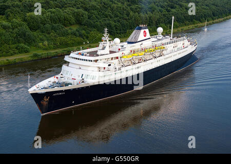 World's oldest active Ocean Liner Astoria (build in 1948) passing through the Kiel Canal on it's way from Amsterdam - Stock Photo