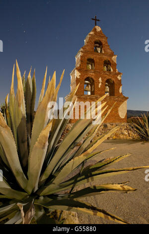 Decorative bell tower and yucca, Mission San Miguel Archangel, near Paso Robles, San Luis Obispo County, CA, USA, - Stock Photo