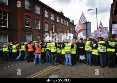 EDL supporters march in central Luton as a heavy police presence separated English Defence League members from a counter protest by Unite Against Fascism.