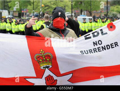 An EDL supporter in central Luton as a heavy police presence separated English Defence League members from a counter protest by Unite Against Fascism.