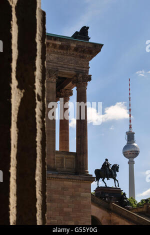 Berlin, Germany. Old National Gallery (Alte Nationalgalerie) with statue of Frederick William IV and the Fernsehturm - Stock Photo