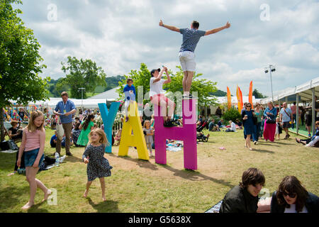 General view of  people attending the annual The Hay Festival of Literature and the Arts, 'the Woodstock of the - Stock Photo