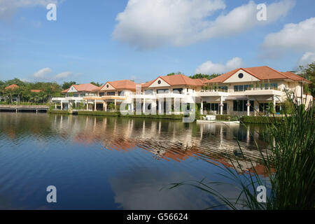 Residential houses around lake in suburbs, Soi Nichida Thani, Pakkret, Northern Bangkok, Thailand, January - Stock Photo