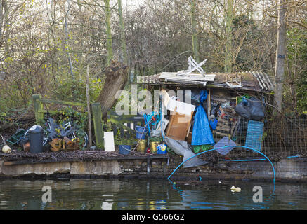 Shack built from rubbish, near St. Pancras Lock, Regent's Canal, Camden, London, England, February - Stock Photo