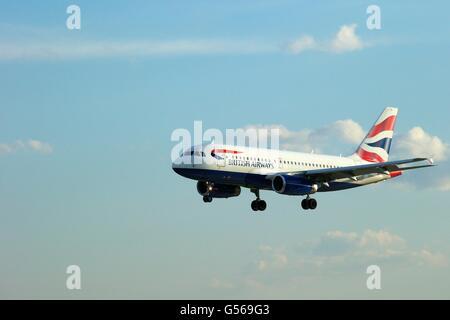 British AIrways Airbus A319  landing at Heathrow Airport, London, England, UK, GB, - Stock Photo