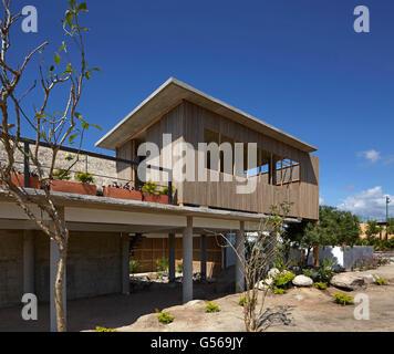 Overall exterior view from side. Casa Cal, Puerto Escondido, Mexico. Architect: BAAQ, 2015. - Stock Photo