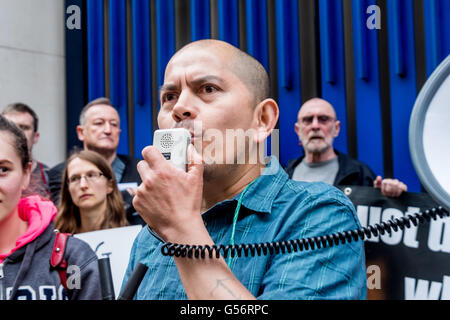 London, UK. June 21th, 2016. One of the striking cleaners speaks at the rally on the 10th day of their strike against - Stock Photo