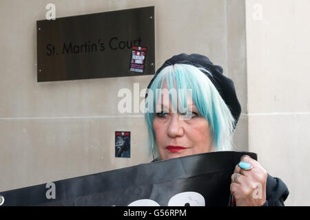 London, UK. June 21th, 2016. Jane Nicholl of Class War holds their banner in front of the CBRE offices at St Martin's - Stock Photo
