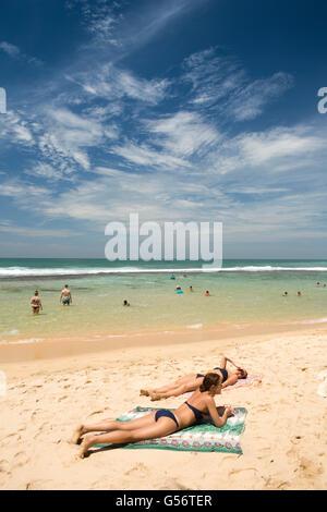 Sri Lanka, Galle Province, Unawatuna, Thalpe, Wijaya beach, women sunbathing on sand - Stock Photo