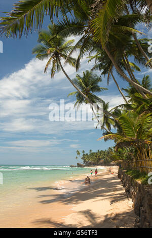 Sri Lanka, Galle Province, Unawatuna, Thalpe, Wijaya beach, people on sand - Stock Photo
