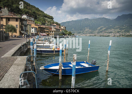 Boat moorings at town on lake island, Peschiera Maraglio, Monte Isola, Lago d'Iseo, Val Camonica, Central Alps, - Stock Photo