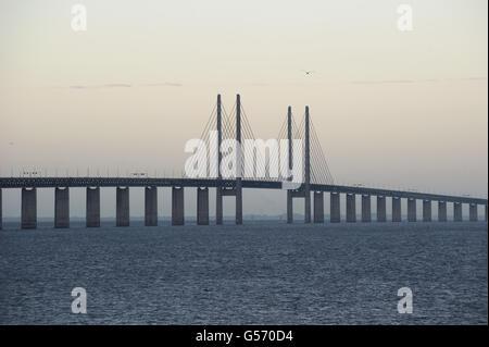 Cable-stayed road and rail bridge at dawn, crossing strait at border with Denmark, Oresund Bridge, Oresund Strait, - Stock Photo
