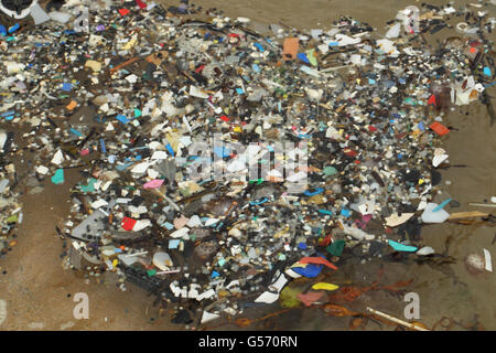 Micro plastics in rockpool, Newquay, Cornwall, England, December - Stock Photo