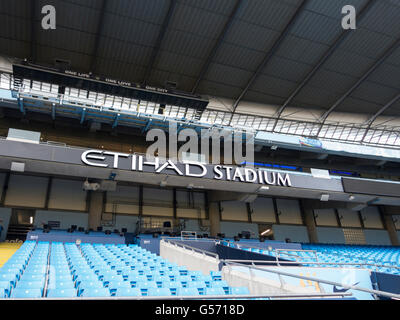 Seats inside Etihad Stadium Manchester CIty Football Club UK - Stock Photo