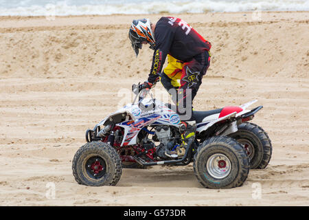 Sand Racing Quad Bike Event On A Beach In England Stock Photo
