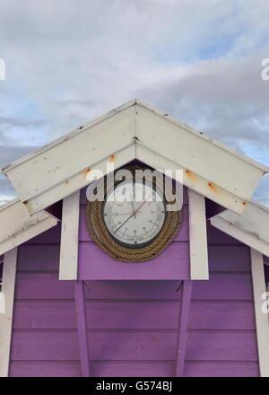 clock in lilac cabin-lofoten - Stock Photo