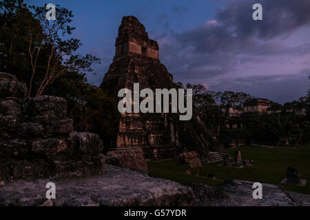Last light on Templo de Gran Jaguar, or Temple 1 in the grand plaza of Tikal ruins in Guatemala, seen from the North - Stock Photo