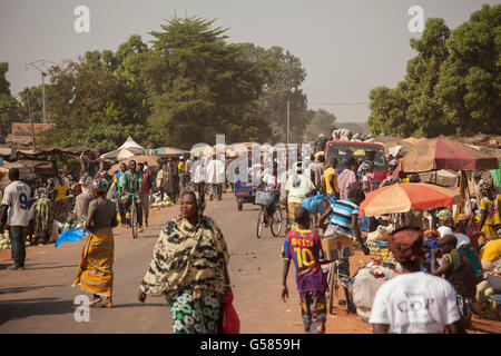 People shop at a busy market in Banwa Province, Burkina Faso. - Stock Photo