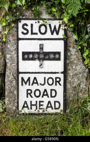 Old fashioned sign warning of major road junction ahead, St Keverne, Lizard peninsula, Cornwall, England, UK - Stock Photo