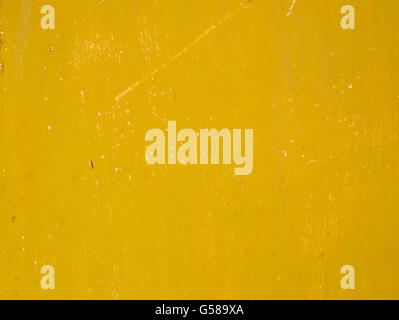 Rusty old metal surface painted in a dirty deep yellow color - Stock Photo