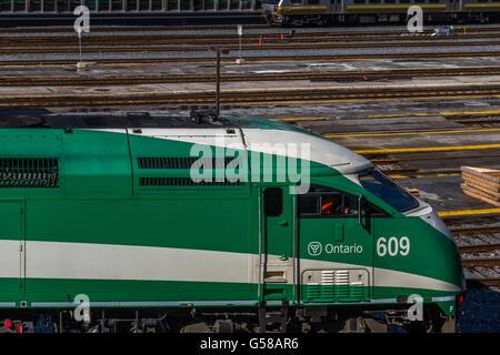 GO Transit Locomotive heading towards Toronto Union Station - Stock Photo
