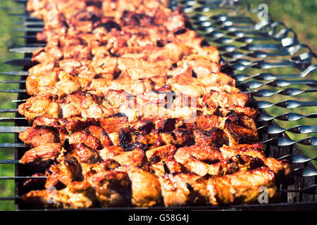 Meat roasted on fire barbecue kebabs on the grill. Selective focus - Stock Photo