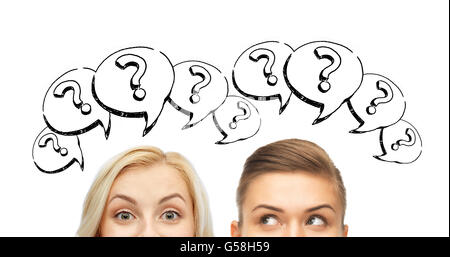 happy young women faces with question marks - Stock Photo