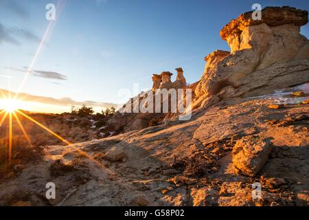 Toadstool shaped rimrocks called hoodoos at sunrise in the Grand Staircase Escalante National Monument near Kanab, - Stock Photo