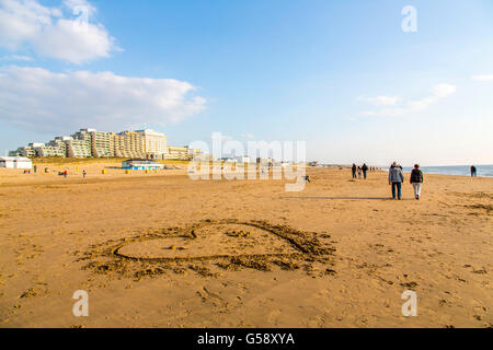 North Sea seaside town Noordwijk, The Netherlands, heart painted in the sand, love symbol, - Stock Photo