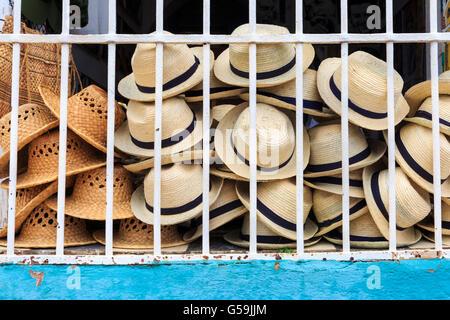Cuban Fedora style straw hats on display in Trinidad, Cuba - Stock Photo
