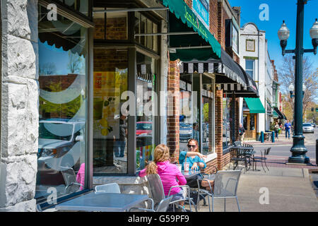 Two women sit in front of the Jamba Juice shop on Main Street in downtown historic Franklin, TN - Stock Photo
