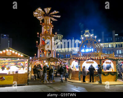 Night scene with people on Christmas Market in Manchester, England, United Kingdom - Stock Photo