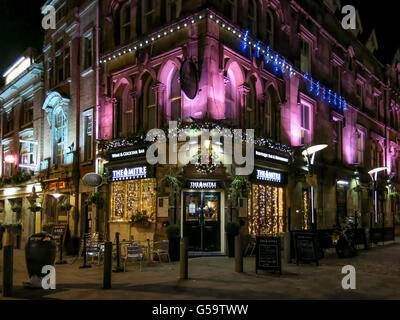The Mitre Bar at Shambles Square by night in the city centre of Manchester, England, UK - Stock Photo