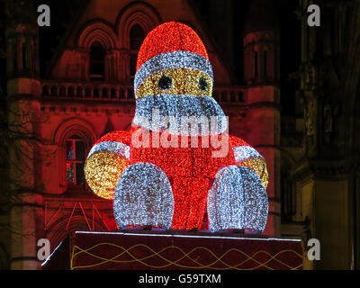 Christmas illuminated Big Santa Claus sitting on town hall in Manchester, England, United Kingdom - Stock Photo