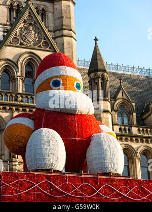Big Santa Claus on town hall overlooking the Christmas Market on Albert Square in Manchester, England, UK - Stock Photo
