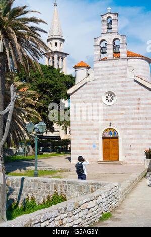 Holy Trinity Church, with the tower of St John in background, Stari grad, old town, Budva, Montenegro, Europe - Stock Photo