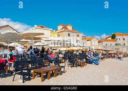 Cafe terraces, Ricardova glava, Richard's Head beach, at old town, Budva, Montenegro, Europe - Stock Photo